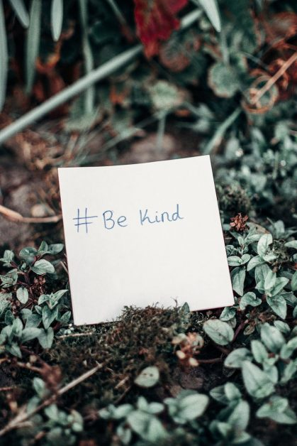 white printer paper with be kind text on plants
